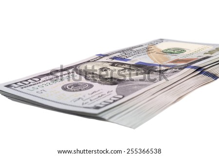 stack of US dollar bills isolated over white   - stock photo