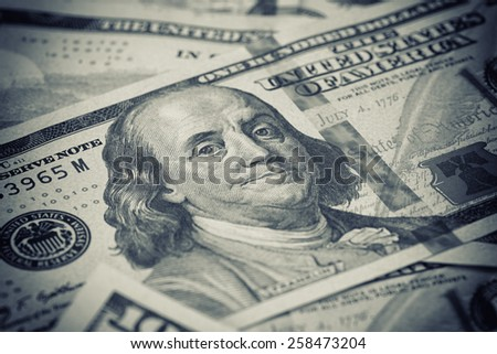 Stack of US Dollars backround. Notes face value of 100 US dollars - stock photo