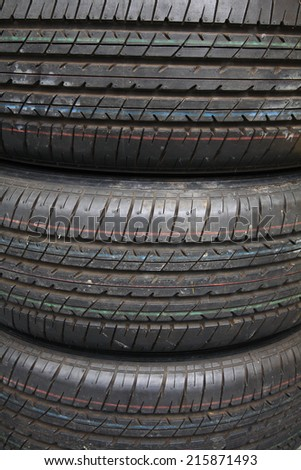 Stack of used tires by texture background