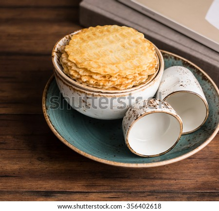 Stack of vanilla waffles on a plate, selective focus - stock photo