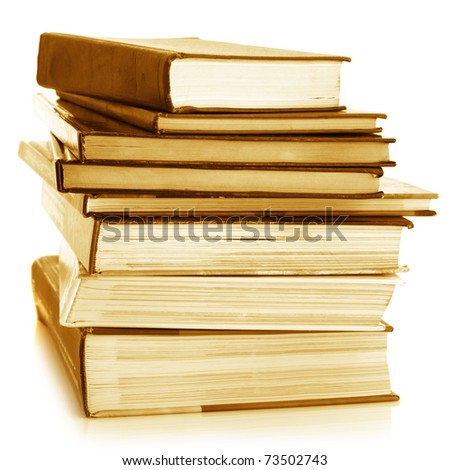 Stack of various books isolated on white background. Toned image.