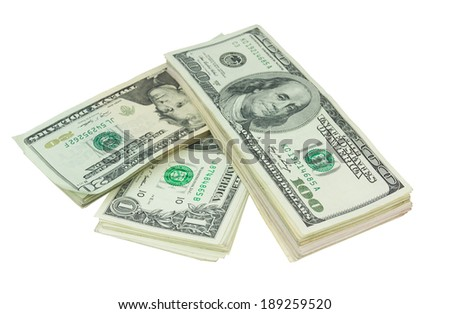 Stack of various denominations dollars isolated on white - stock photo