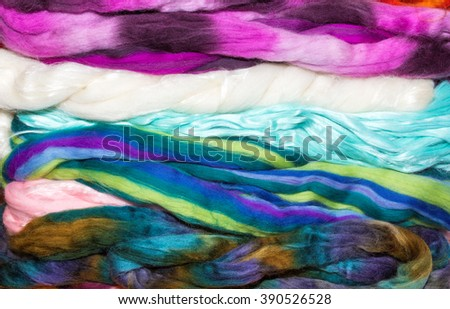 Stack of various natural fibers woven into fleece material - stock photo