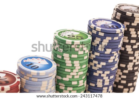 Stack of various poker chips isolated on white - stock photo