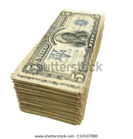 stack of vintage American money isolated on white background (version with depth of field) - stock photo