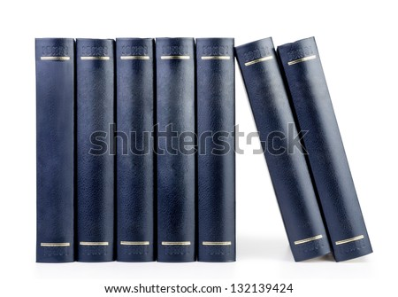 stack of vintage black books in row isolated on white background - stock photo