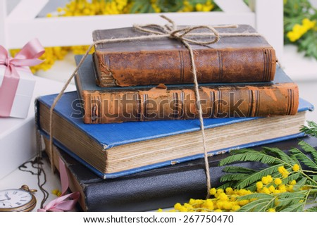 stack of vintage old books  on table - stock photo