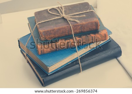 stack of vintage old books, retro toned - stock photo