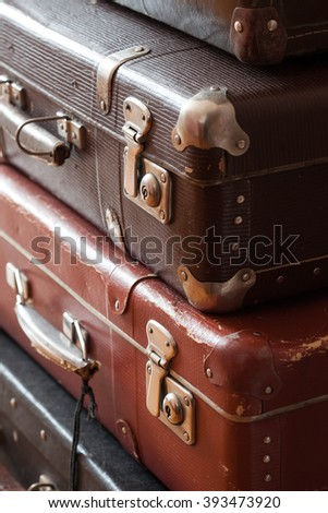 stack of vintage suitcases closeup still life