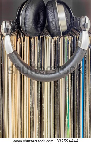 Stack of vinyl records with headphones on top. Music concept. - stock photo