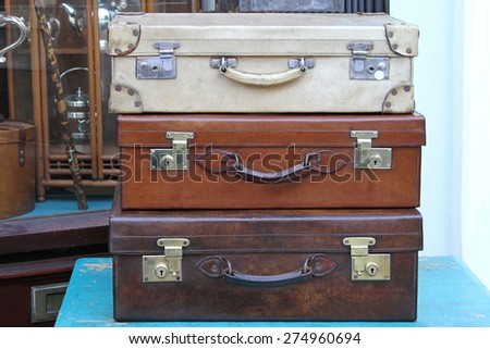 Stack of vitage travel style leather suitcases - stock photo