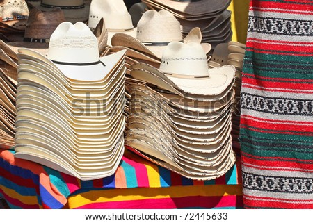 Stack of western hats at the market