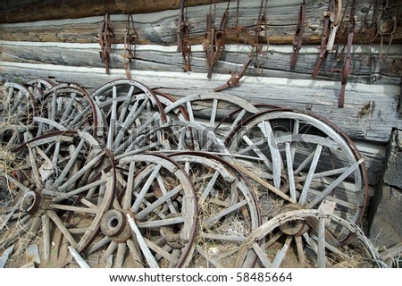 Stack of wheels used for wagons - stock photo