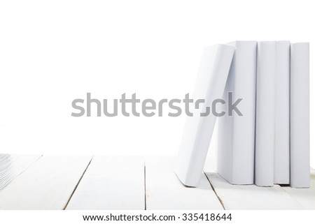 Stack of white books on wooden table isolated on white background. Back to school. Copy space for text - stock photo