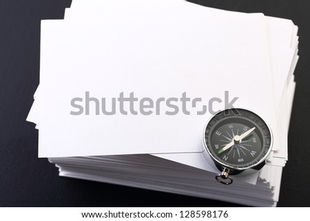 Stack of white cards and compass