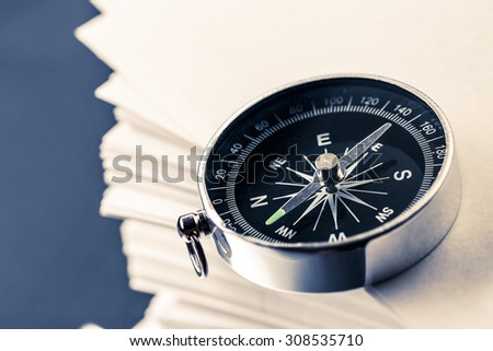 Stack of white cards and compass closeup - stock photo