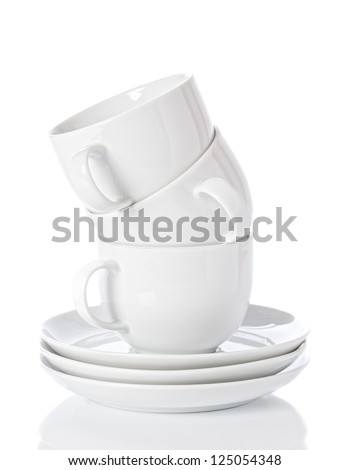 Stack of white china cups and saucers on a white background - stock photo