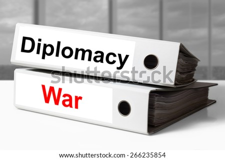 stack of white office binders diplomacy war
