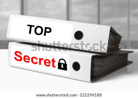 stack of white office binders top secret documents lock symbol