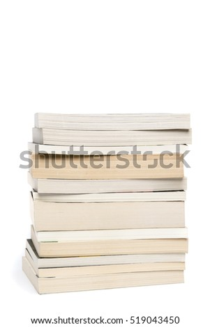 Stack of white paperback books isolated on white background with copyspace