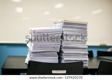 Stack of white papers sheet on office background.