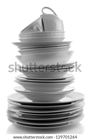 Stack of white plates and dishes - stock photo
