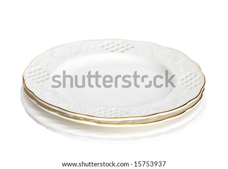 stack of white plates isolated - stock photo
