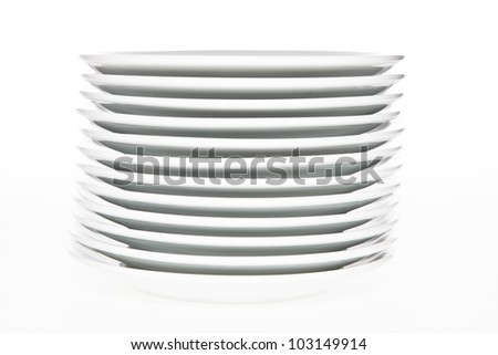 Stack of white plates on white background. - stock photo