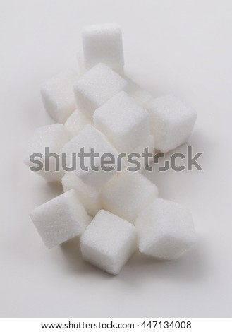 stack of white sugar cube against a white background