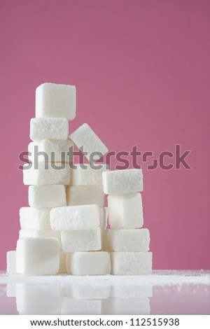 Stack of White Sugar Cubes - stock photo