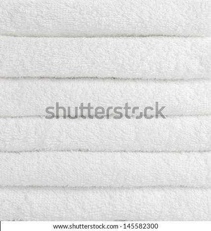 stack of white towels - stock photo