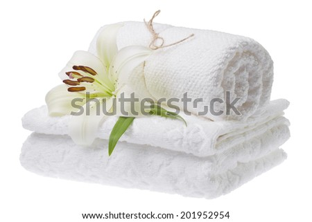 Stack of white towels with lily, isolated - stock photo