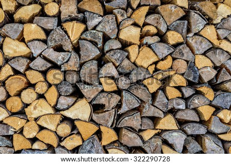 Stack of wood, firewood, background - stock photo