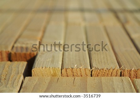 Stack of wood in a new residential community. - stock photo
