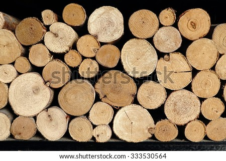 Stack of wood logs, wooden abstract background - stock photo