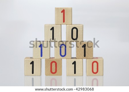 Stack of Wooden Blocks with binary code on White Background - stock photo