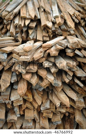 stack of wooden fence posts close up
