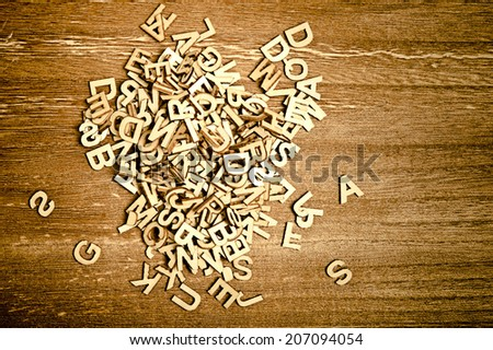 stack of wooden letters - stock photo