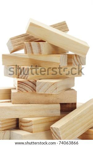 Stack of wooden rectangular blocks on white background - stock photo