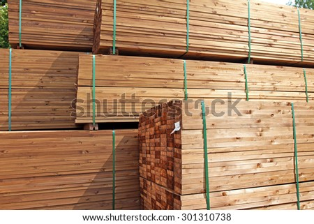 stack of wooden terrace planks at the lumber yard - stock photo