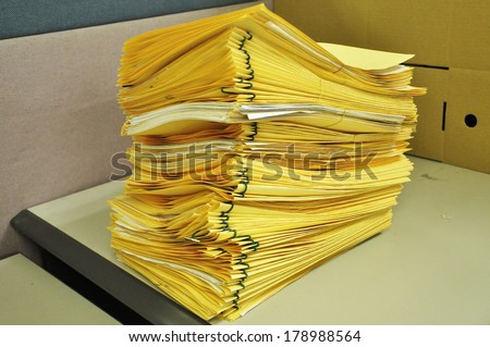 Stack Of Yellow Folders On The Table - stock photo