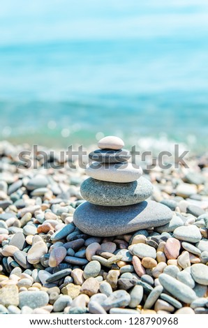stack of zen stones near sea - stock photo