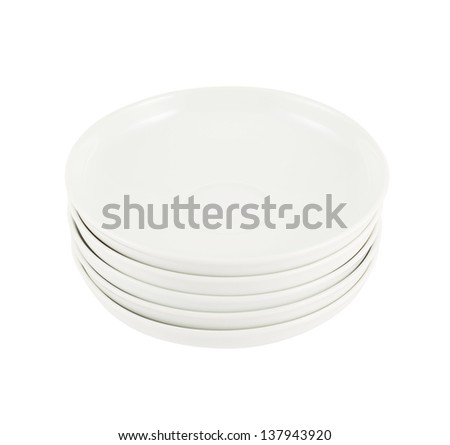 Stack pile of clean white ceramic plate dishes isolated over white background