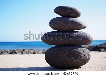 Stack sea pebbles against the blue sea