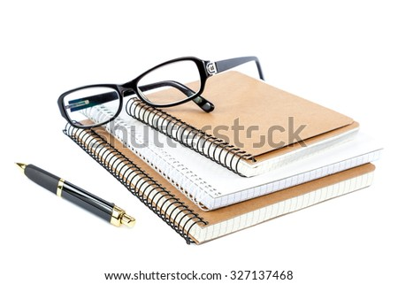 Stack stylish notebook, pen and glasses isolated on white background. - stock photo