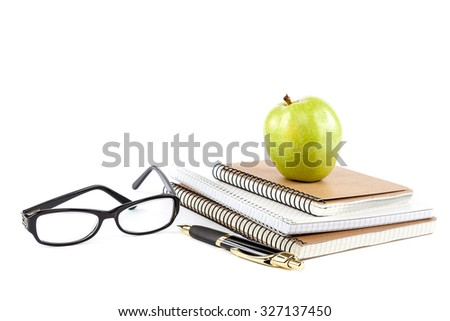Stack stylish notebook, pen and glasses isolated on white background. Office or school supplies. - stock photo