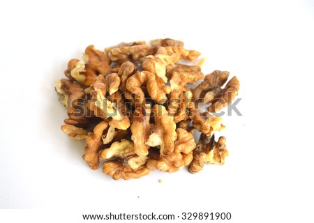 Stack walnut pieces and halves on a white background