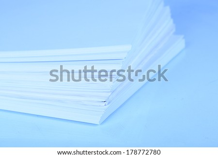 Stack white paper close-up in blue light