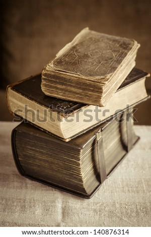 Stack with old books on the table. - stock photo