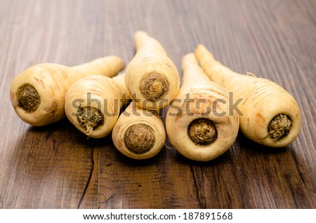 Stack with parsnips on a wooden table